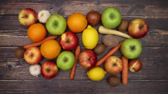 Vegetables and fruits on wooden table - Stop Motion