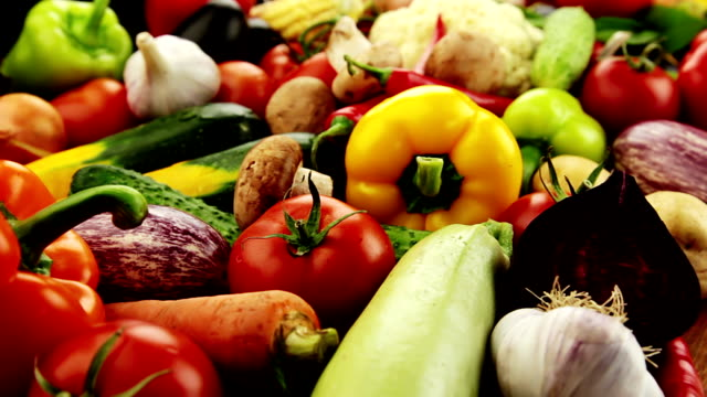 Vegetables. Close-up Fresh vegetables: cabbage, carrot, corn, cucumber, garlic, onion, pepper, potatoes, salad, tomato, mushrooms. The camera moves slowly past. ingredient stock videos & royalty-free footage