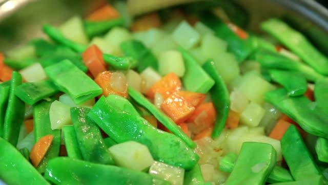 Vegetables cooking in pot video