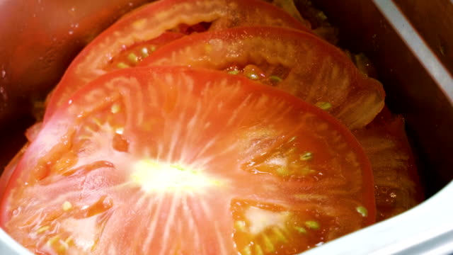 Vegetables for salad preparation. Close-up shot of chopped tomatoes. 4K