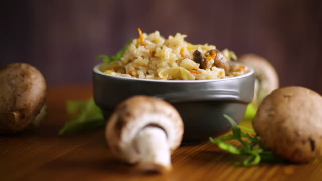 vegetarian cooked rice with mushrooms in a ceramic bowl video