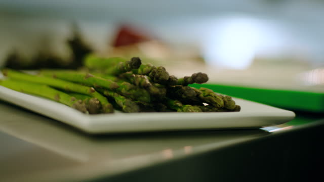 Vegetarian meal - healthy asparagus Close up of fresh asparagus in a commercial kitchen in a fine dining restaurant. fat nutrient stock videos & royalty-free footage