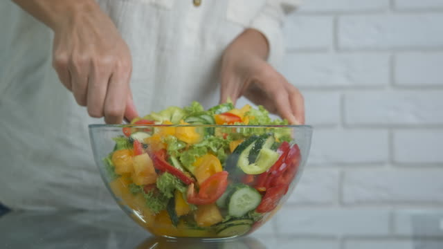 vegetarian vegetable salad. - nazionalità russa video stock e b–roll