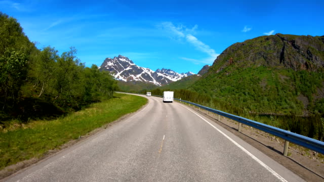 Vehicle point-of-view Driving a Car VR Caravan travels on the highway. Tourism vacation and traveling. Beautiful Nature Norway natural landscape.