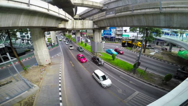 Vehicle traffic and motion at junction on road in Bangkok video
