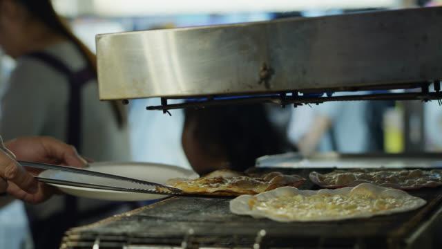 Vendor taking Pancake Off Grill in Raohe Night Market