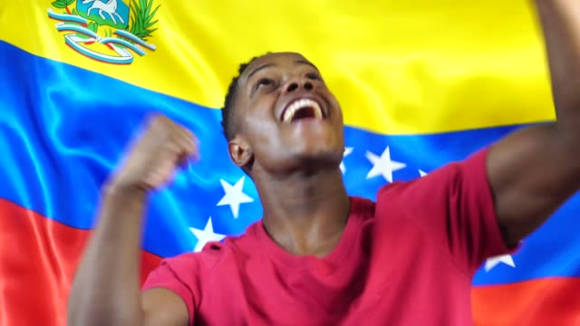 Venezuelan Young Black Woman Celebrating with Venezuela Flag video