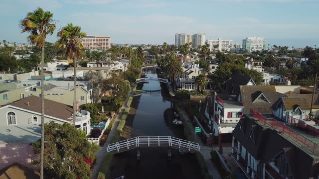 Venice Beach Canals California - Pullback Aerial Drone Shot Aerial drone shot of the canals in Venice Beach California, overlooking Marina Del Rey. charming stock videos & royalty-free footage