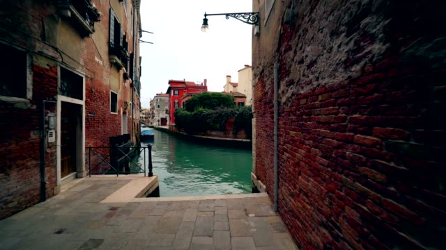 Venice Italy canal with no traffic green water and old houses 4K video