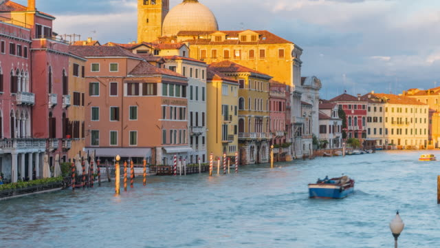 Venice, Italy, Europe, historic culture and famous travel with Renaissance and Gothic architecture waterfront, a view from Scalzi bridge. October,30th, 2018, Venice, Italy, Europe. Venice, historic, culture and famous travel by Renaissance and Gothic architecture waterfront, a 4K footage view from Scalzi bridge with busy activity Grand Canal waterfront with the dome of Chiesa di San Simeone Piccolo, the Catholic church and private boat pier at the romantic sunset view. neo gothic architecture stock videos & royalty-free footage