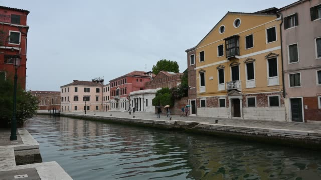 venice, italy - historic buildings between the canals of the lagoon city - passenger craft stock videos & royalty-free footage