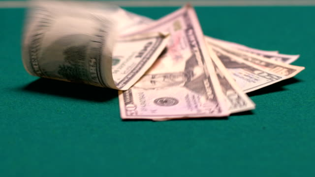 Venturous person throwing big sum of dollars on gaming table, large money bets
