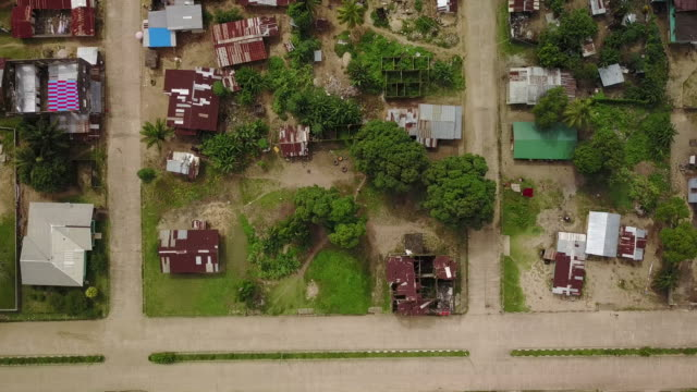 vertical aerial over third world african country town block - liberia video stock e b–roll