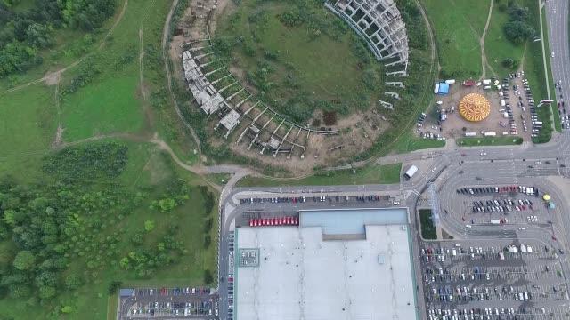 Vertical Flight Over Supermarket And Abandoned Stadium video