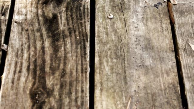 Vertical pan of wooded deck. video