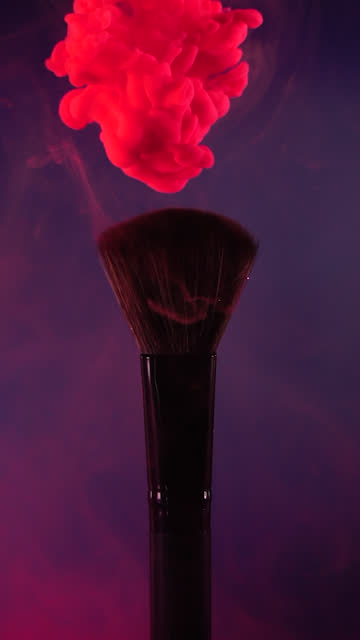 Vertical: Red ink drop falling on brush with blue background in slow motion Vertical video format and Slow motion of Red ink drop falling on make up brush paint with blue background painting art product stock videos & royalty-free footage