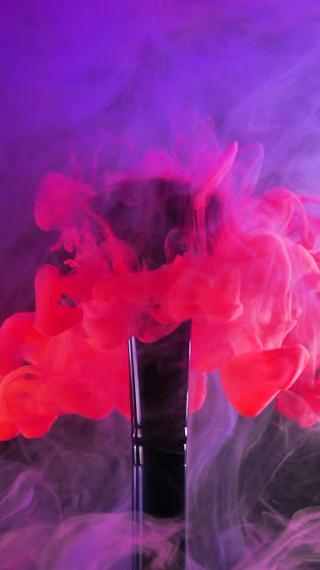 Vertical: Red ink drop falling on brush with blue smoke background in slow motion Vertical video format and Slow motion of Red ink drop falling on make up brush paint with blue smoke background painting art product stock videos & royalty-free footage