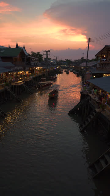 vertical shot of amphawa floating market in twilight time. - vertical format video stock videos and b-roll footage
