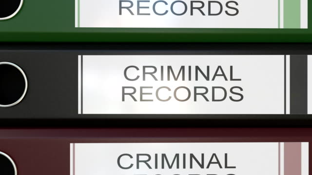 Vertical stack of multicolor office binders with Criminal records tags 3D rendering video