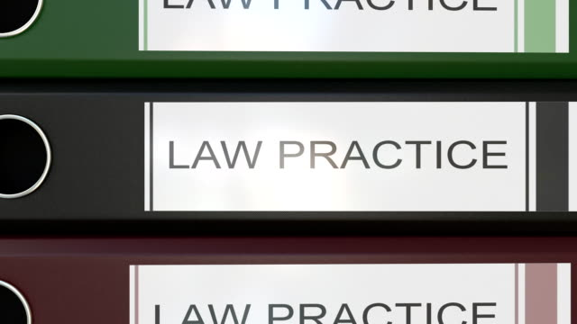 Vertical stack of multicolor office binders with Law practice tags 3D rendering video