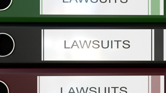 Vertical stack of multicolor office binders with Law suits tags 3D rendering video
