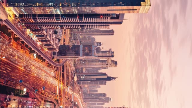 Vertical time lapse - Dubai skyline and traffic vein at sunset video