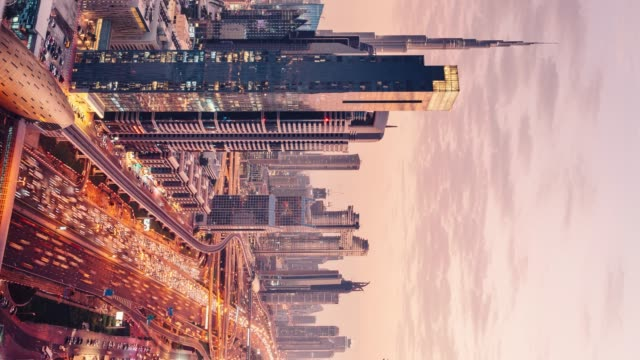 Vertical timelapse cityscape and skyscrapers from day to night video