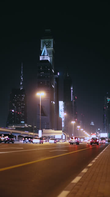 vertical video of night traffic at the sheikh zayed road in dubai - vertical format video stock videos and b-roll footage