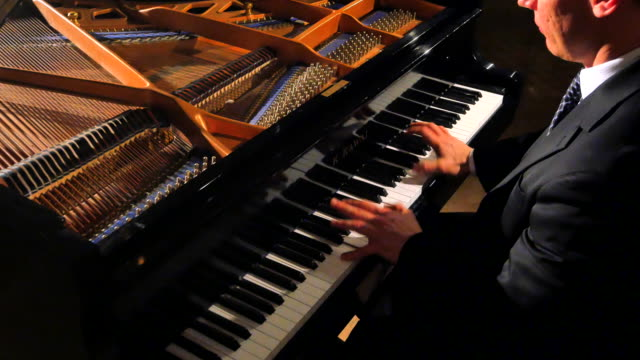 Very Animated Playing Hands, Male Pianist Seated at Open Grand Piano video