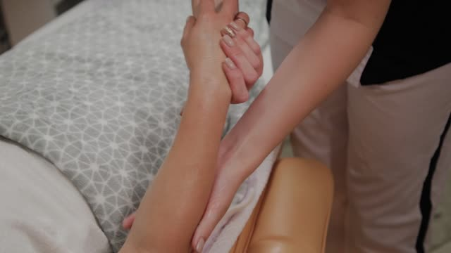 Very beautiful girl gets a massage on her hands in the spa salon Very beautiful girl gets a massage on her hands in the spa salon massage oil stock videos & royalty-free footage