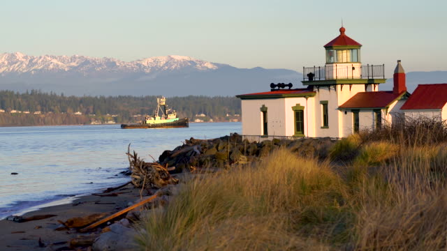 Vessel Passing West Point Lighthouse Puget Sound Seattle Washington A boat passes West Point Lighhouse in the Puget Sound at Dawn seattle stock videos & royalty-free footage