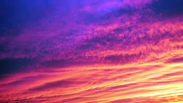 Vibrant colors on rain clouds. From sunset to night. Colors of clouds were yellow, orange and red-purple at sunset, and then became blue. Fast motion. saturated color stock videos & royalty-free footage
