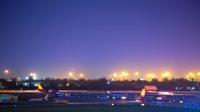 Vibrant Commercial Aviation Airport Airfield Action Timelapse at Night video