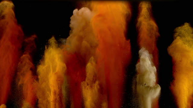 slo mo ld vibrant spices exploding into the air - специя стоковые видео и кадры b-roll