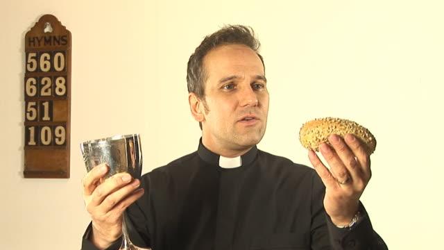 Vicar / Priest at Communion in church service video