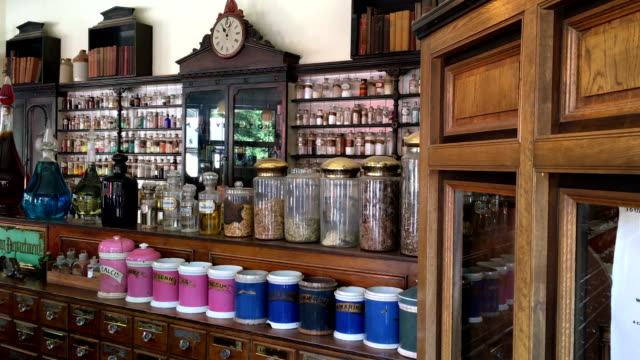 victorian chemist shop with old medicines and displays - stile del xix secolo video stock e b–roll