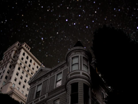 Victorian House at Night Starbright night above a Victorian House 19th century style stock videos & royalty-free footage