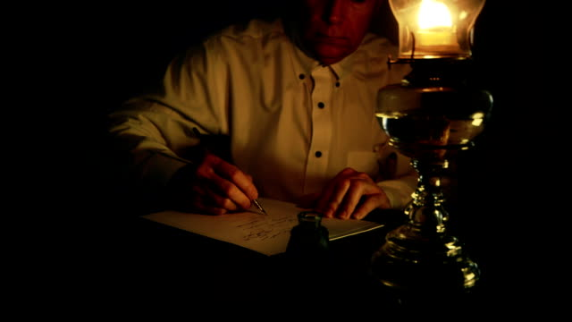 Victorian man using a dip pen to write video