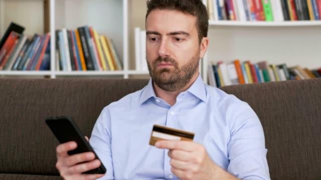 video about home banking using credit card - fare una prenotazione video stock e b–roll