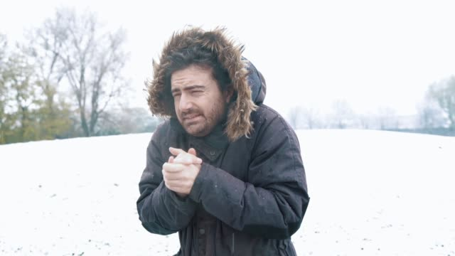Video about one man suffering cold outdoors Video about one man suffering cold in snow day shivering stock videos & royalty-free footage