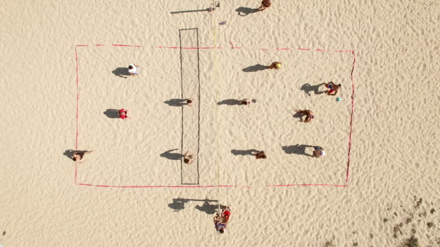 4k video aerial view beach-volleyball - volleyball stock-videos und b-roll-filmmaterial