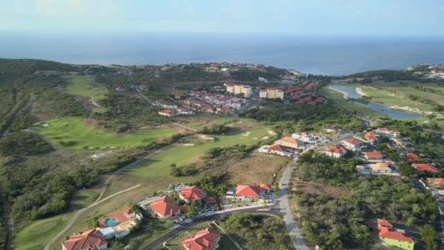 4K Video Aerial View of a Residential Area and Golf Course in Curacao 4K Video Aerial View of a Residential Area and Golf Course in Curacao caribbean sea stock videos & royalty-free footage