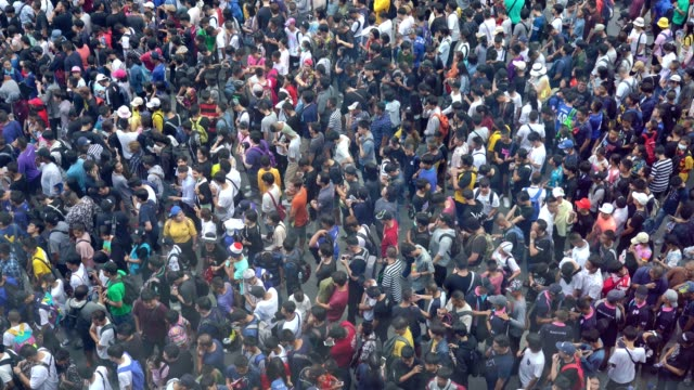 4k video: aerial view of crowded people. - folla video stock e b–roll