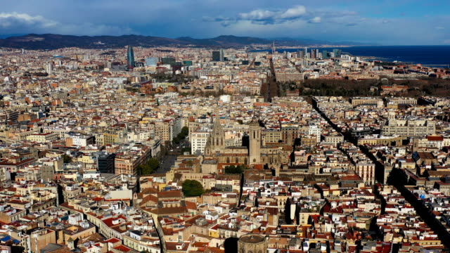 Video aerial view to Barcelona city center Gothic Quarter and Cathedral of the Holy Cross and Saint Eulalia. Video footage Video aerial view to Barcelona city center Gothic Quarter and Cathedral of the Holy Cross and Saint Eulalia. Video footage. Sunny beautiful day general view stock videos & royalty-free footage