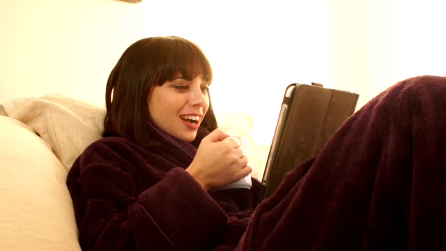 Video call to family and friends in Dressing gown (Bed) video