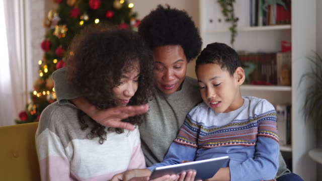 video call with family on christmas day during pandemic - video call with family stock videos & royalty-free footage