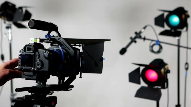 DSLR video camera slider with studio lights video