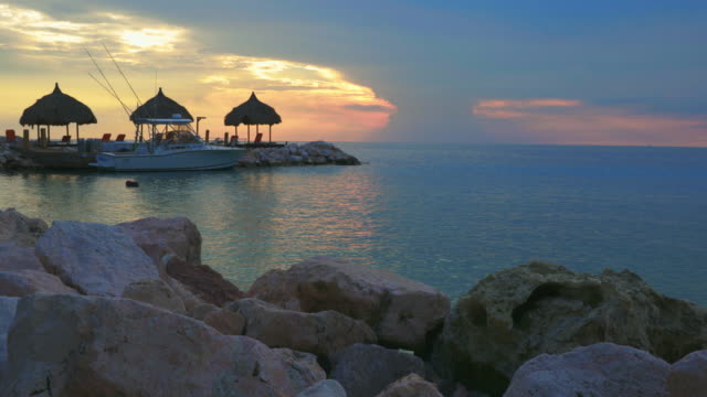 4K Video Caribbean Seascape of Curacao and Lagoon at Sunset 4K Video Caribbean Seascape of Curacao and Lagoon at Sunset curaçao stock videos & royalty-free footage