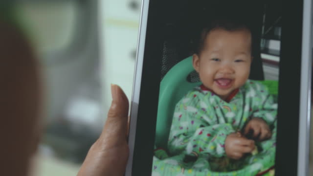Video chat : Little baby eating at home