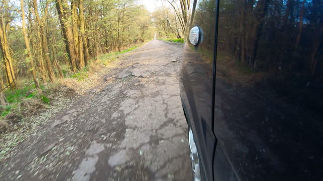 Video clip of a car driving through the countryside. video